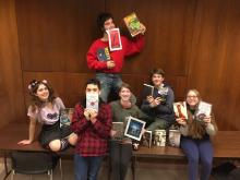 groups of teens holding books
