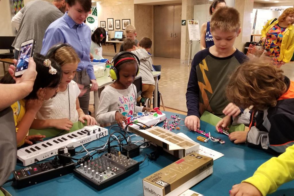 Kids playing with synthesizers in the Launch Pad