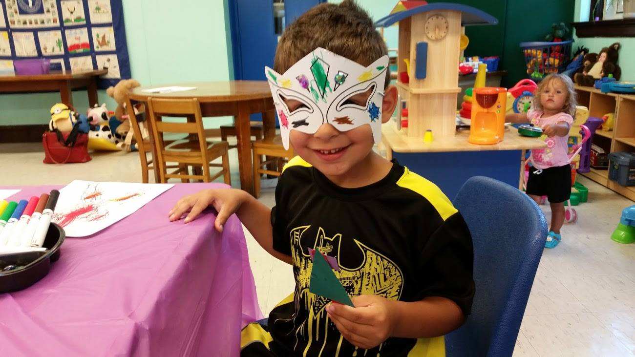 a boy wearing fancy mask